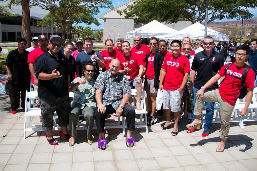 Group photo of UHWO male staff wearing women shoes