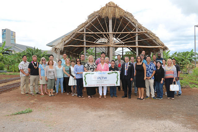 Representatives of PLTW, UH West Oʻahu, and educators gather for partnership blessing.
