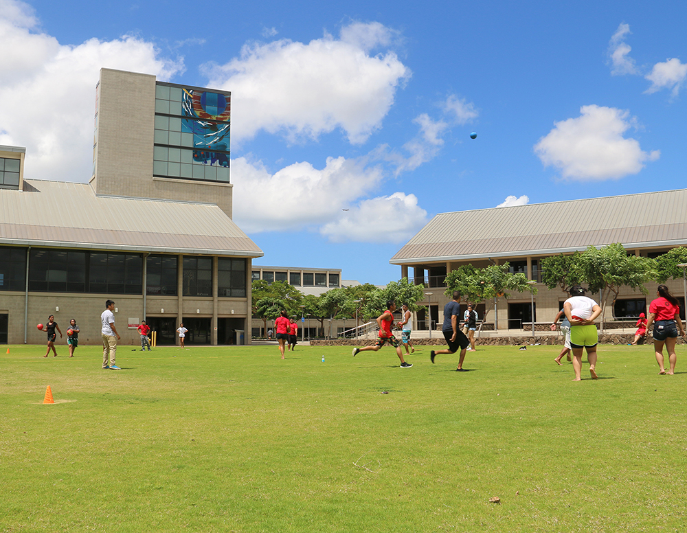 Students playing dodge ball on the UH West Oʻahu Great Lawn.