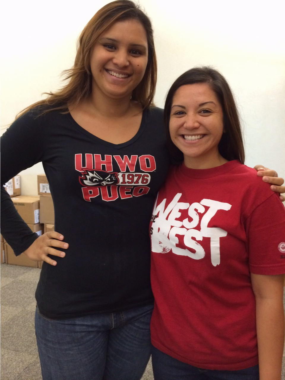 Staff posing wearing UHWO apparel