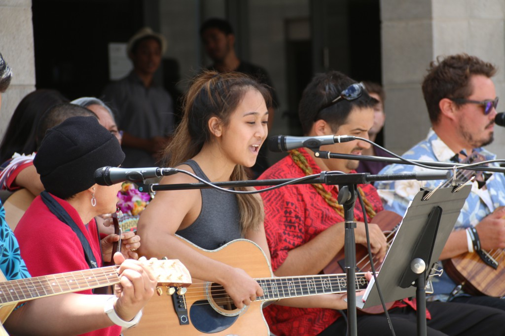 Hawaiian Ensemble students perform in front of the UHWO Campus Center.