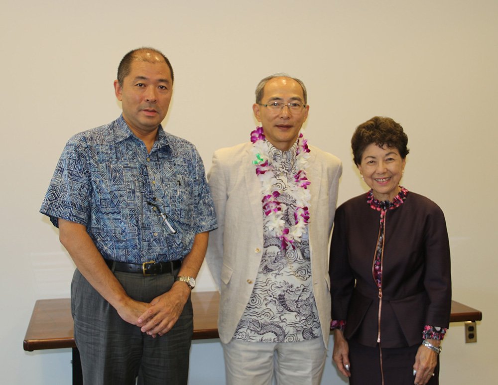 Group photo of Takuya Yoshimura, HTIC Chancellor, Yosuchi Misawa, Consul General and Dr. Doris Ching, UHWO VCAA