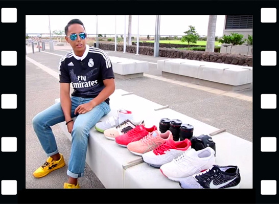 Joseph Centeno Cid Jr. sitting on bench with his displayed shoes