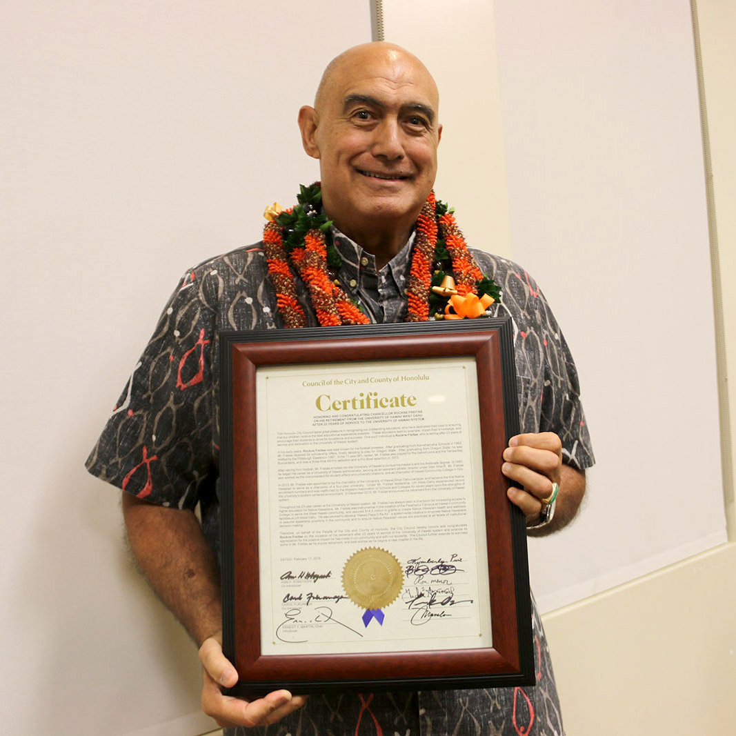 Former UH West Oahu Chancellor Rockne Freitas poses with his honorary certificate from the Honolulu City Council.