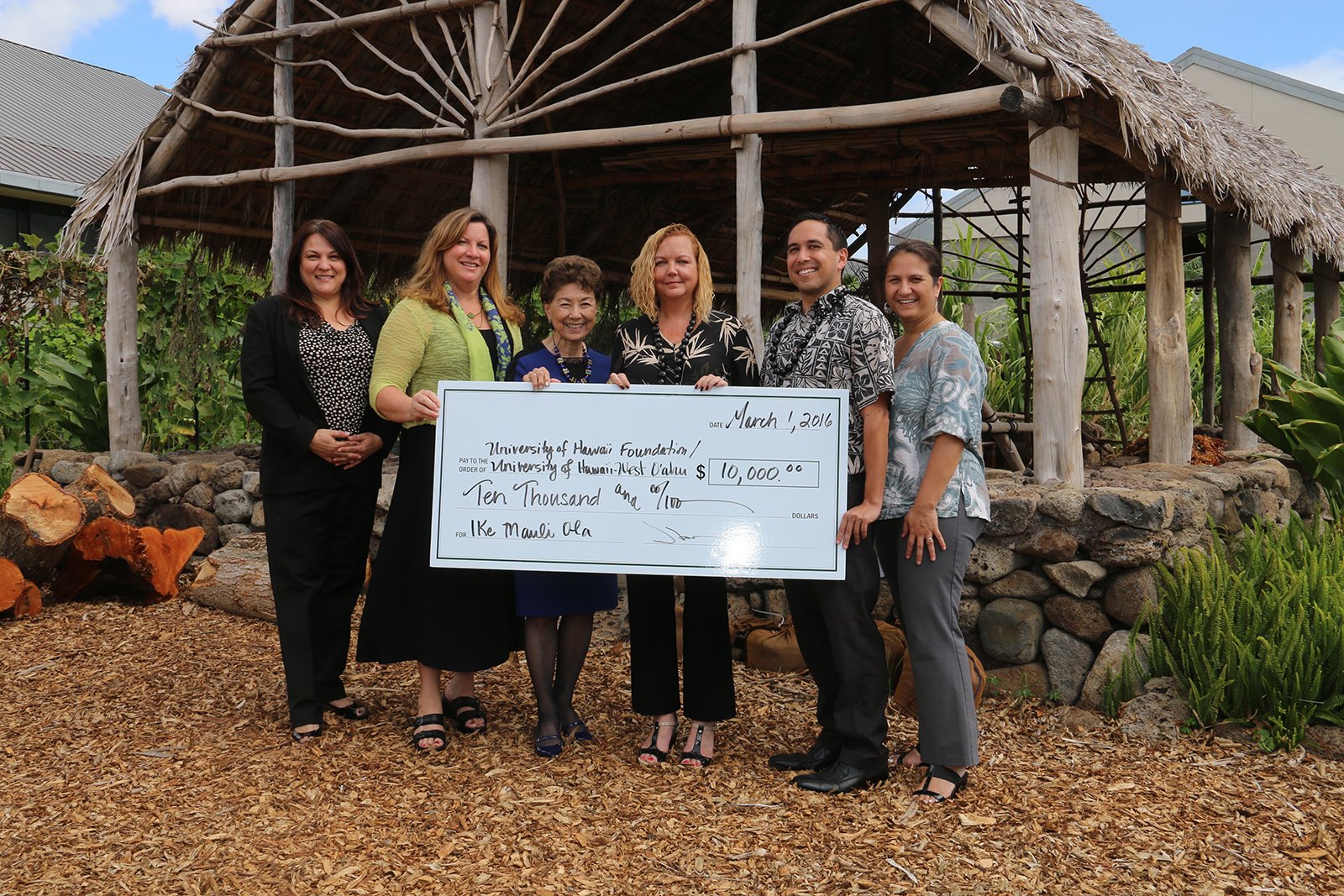 Ohana Health Plan presenting a check to UH West Oahu