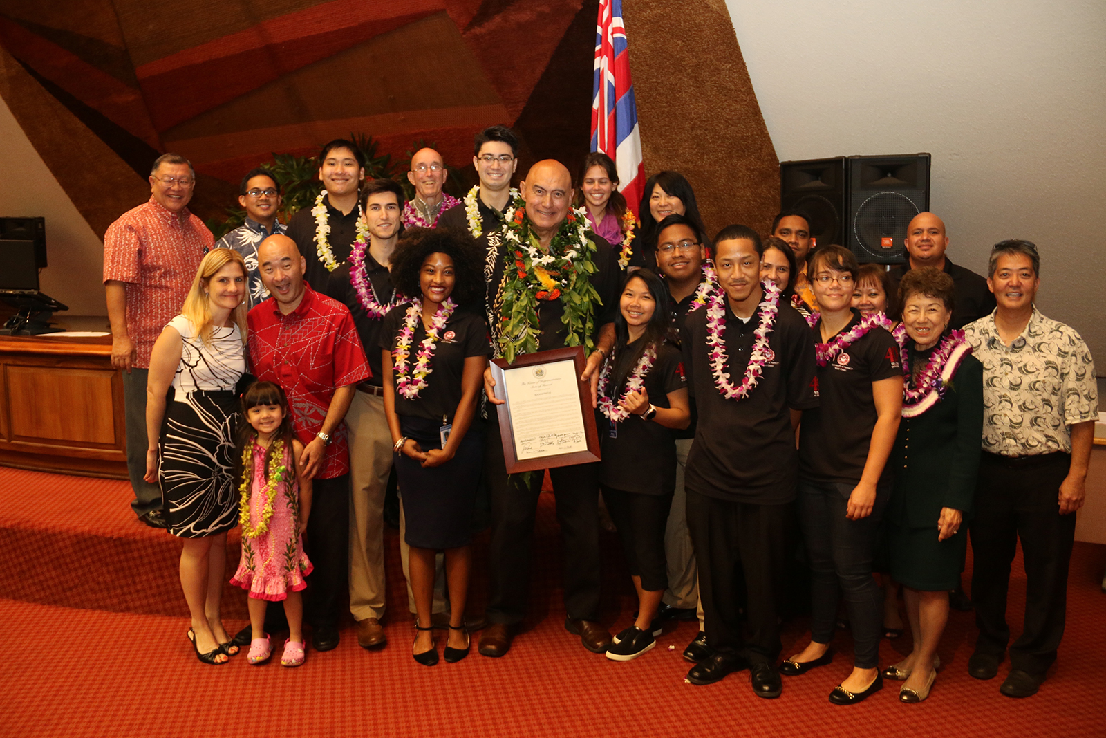 Former Chancellor Rockne Freitas poses with his House Resolution and members of the UH West Oahu staff and legislative interns.