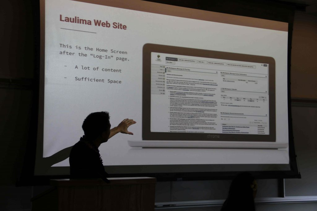 Creative media student Ken Tom discusses his Laulima mobile app senior project at the Humanities Student Conference on April 29.