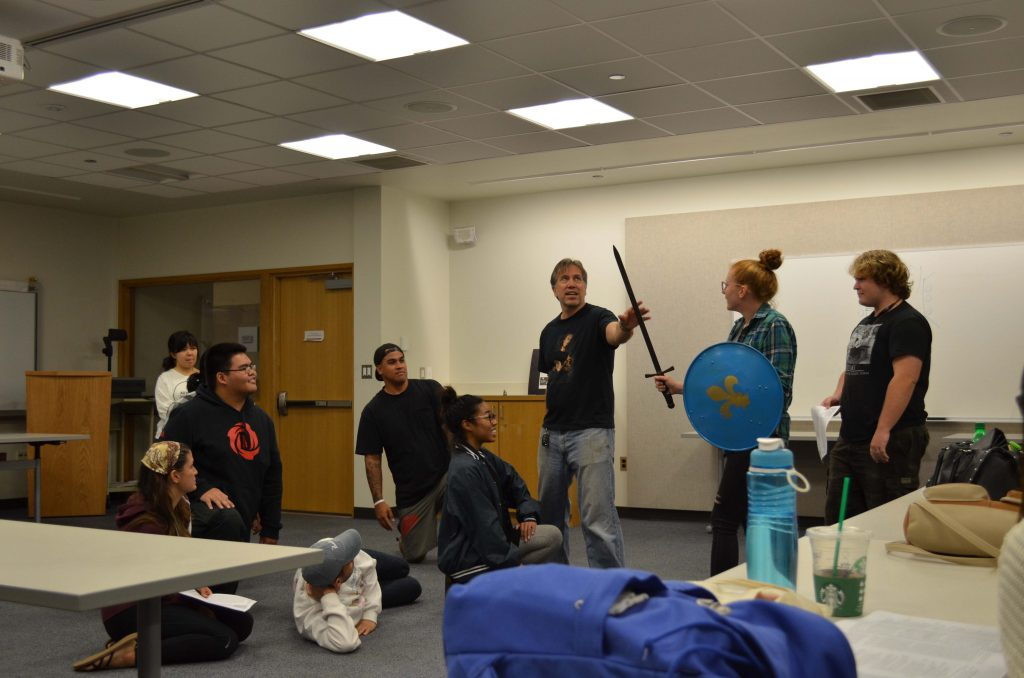 """UH West Oʻahu ENG445 Shakespeare students stage a fight scene from Shakespeare's """"Richard III"""" under the direction of the Hawaii Shakespeare Festival's Tony Pisculli."""