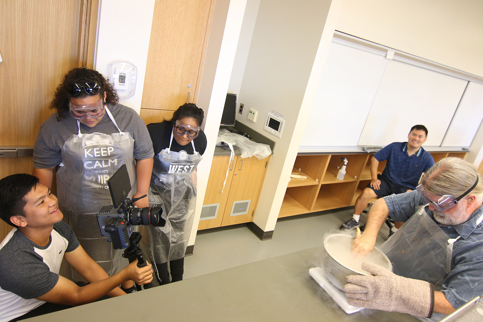 UH West Oahu creative media students shoot scenes in a laboratory for a fall 2016 commercial.