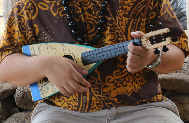 Person playing a ukulele