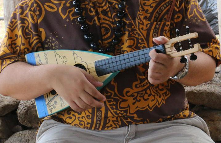 Person playing a ukulele