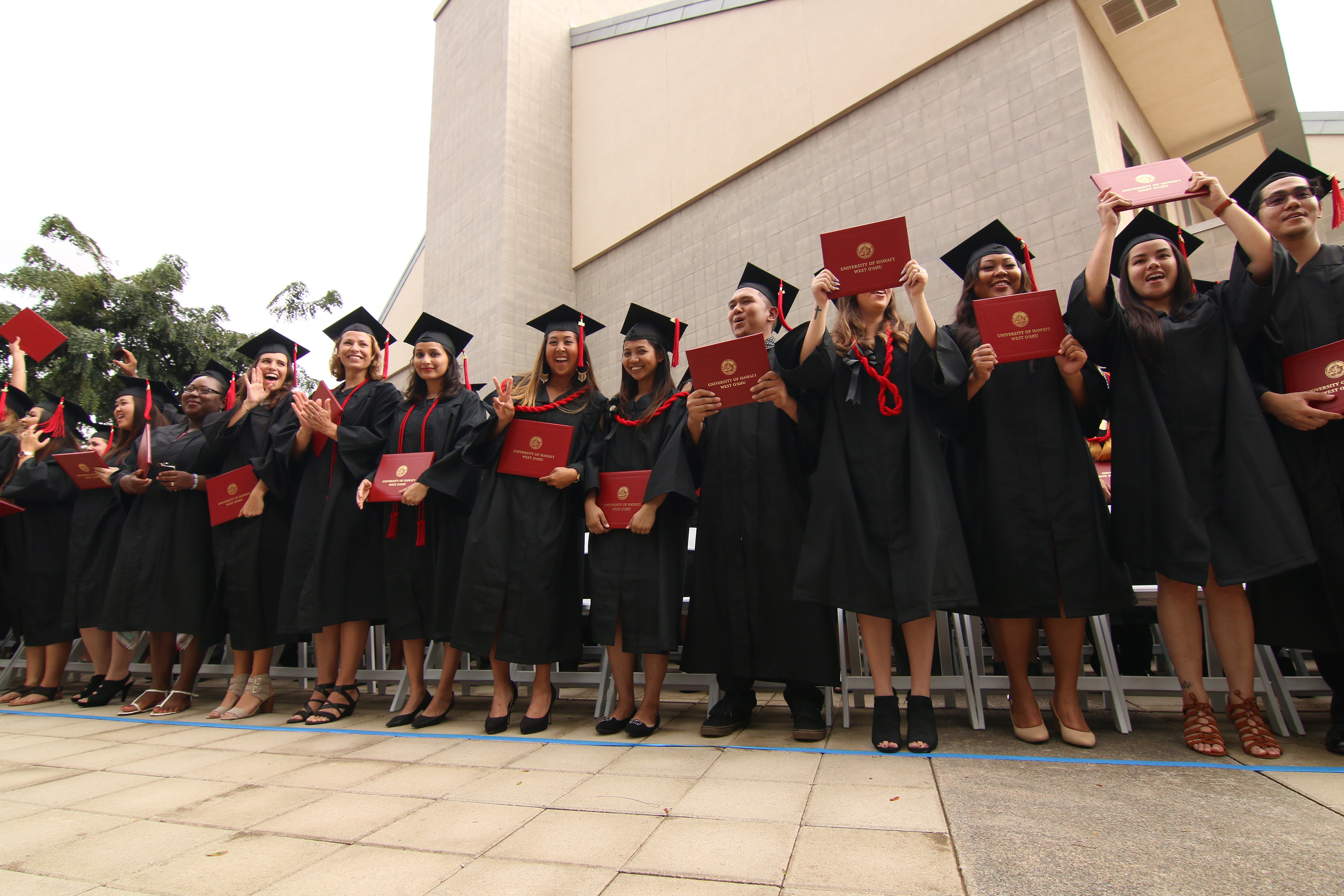 Members of the Fall 2016 graduating class celebrate during commencement.
