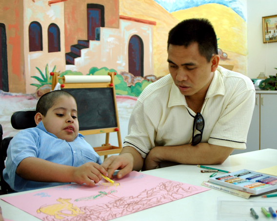 Picture of SPED teacher helping a student