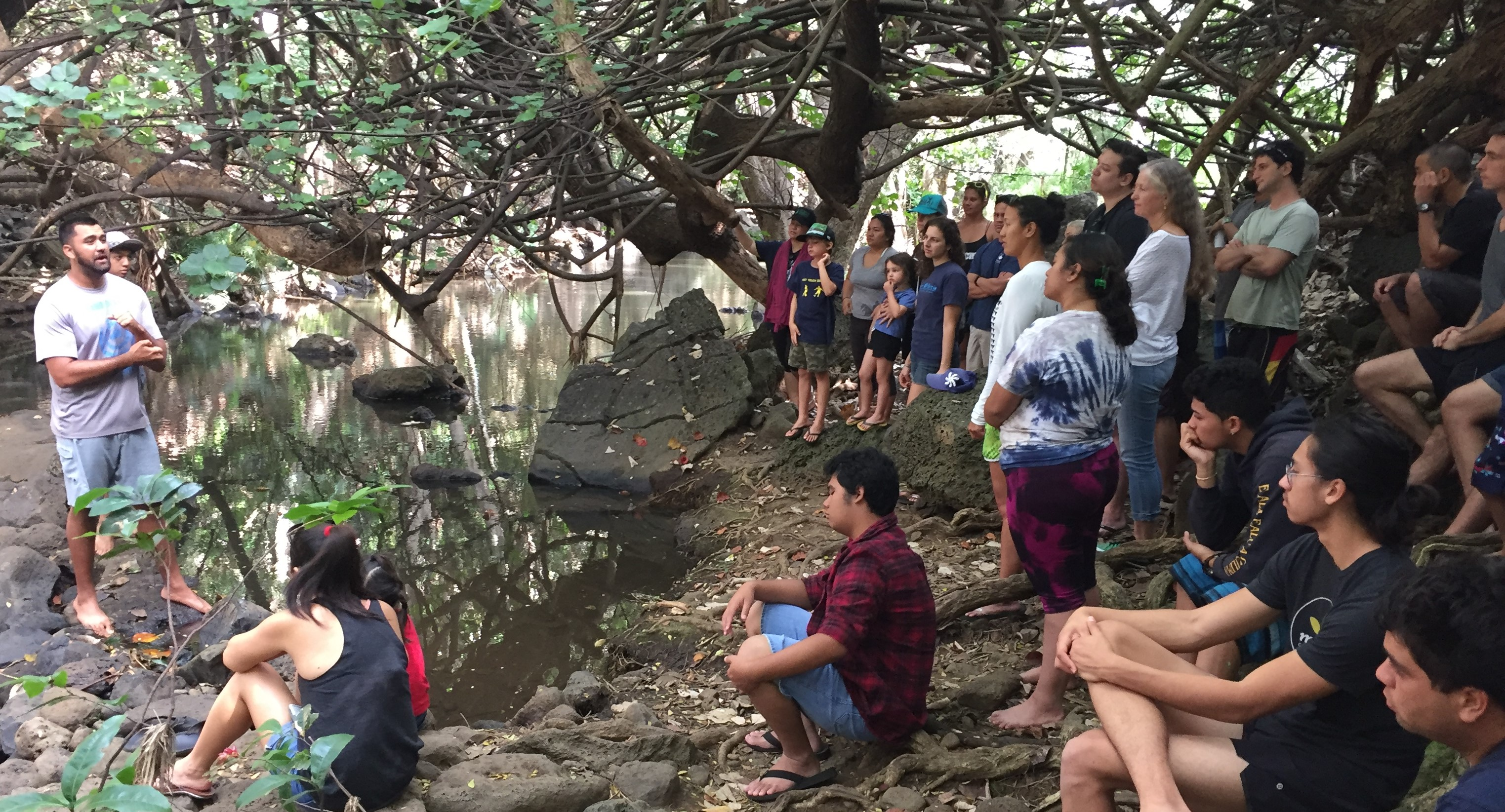 Photo of Participants at the Purple Prize Kick-Off day in March learning about the ʻauwai system for growing taro at Kānewai Loʻi in Mānoa