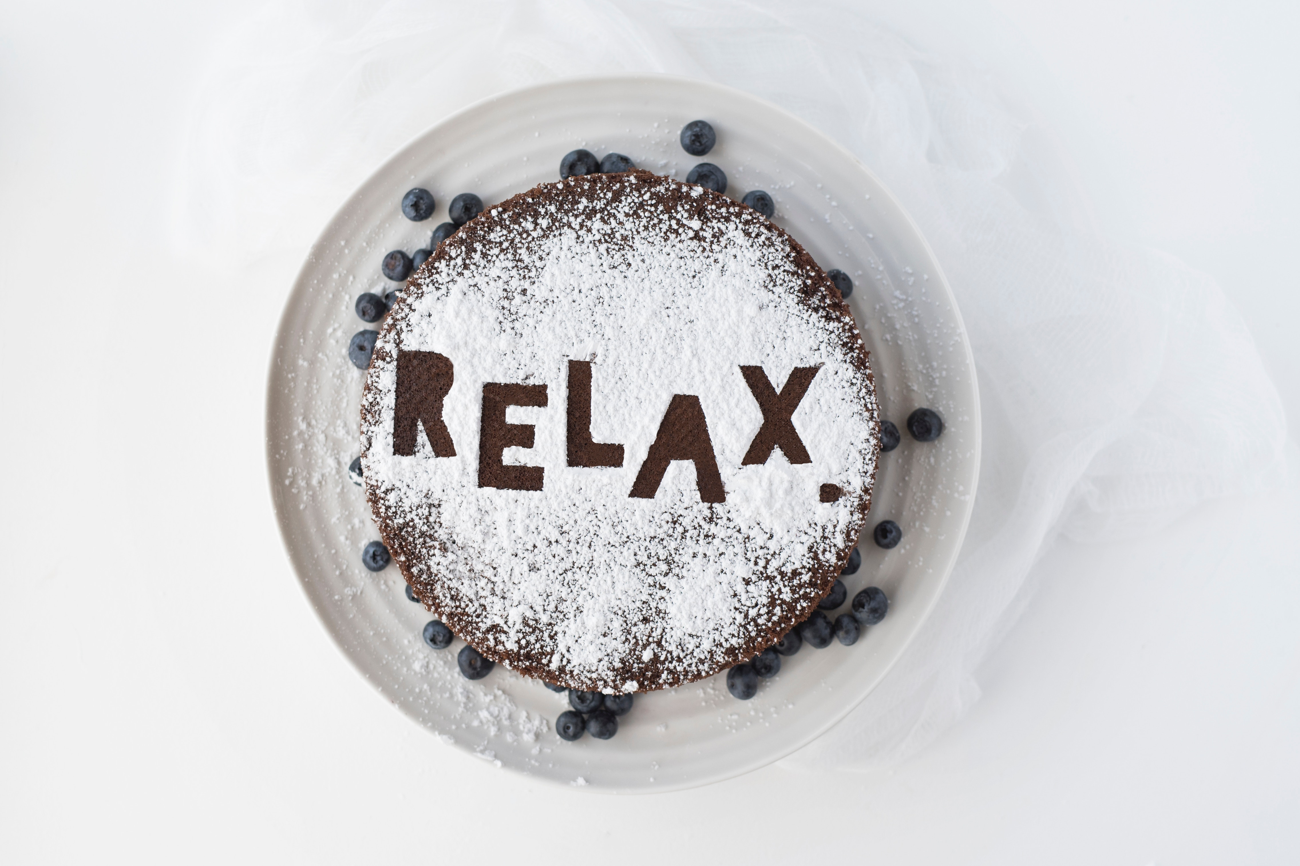Photo of pancakes with word Relax spelled out in powdered sugar