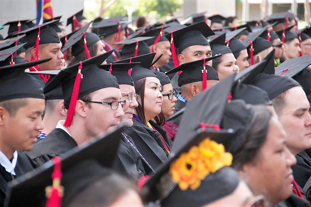 photo of graduates sitting during ceremony