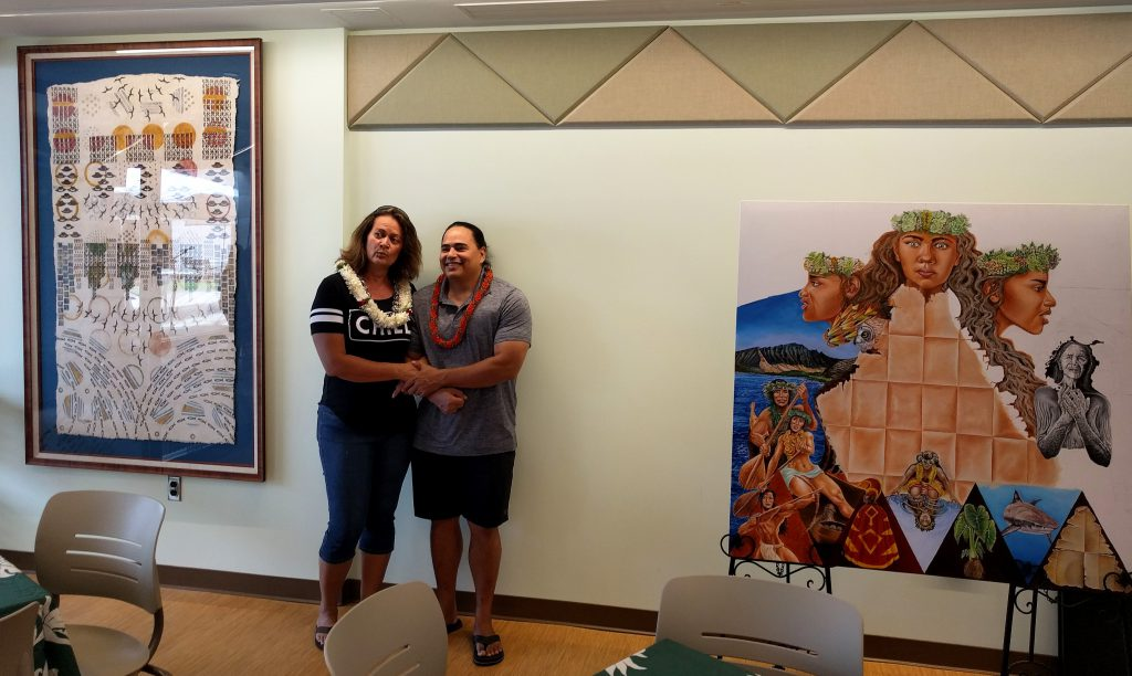 Tanahy (l) and Kupihea pose with their artwork in the Nāulu Center.