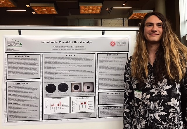 Photo of Arion Northrop and his research poster