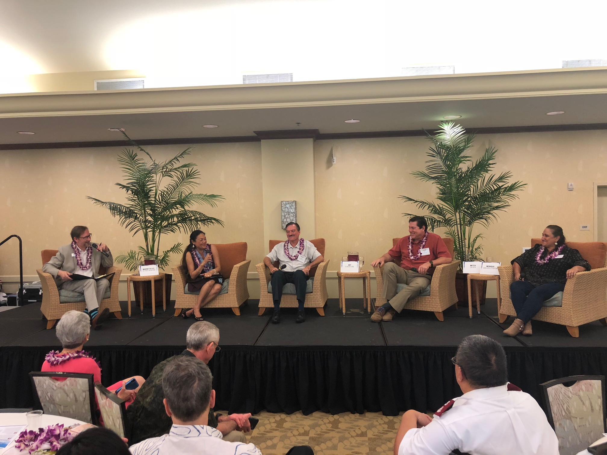 """The """"West Oʻahu Means Business"""" panel, with (from left) moderator A. Kam Napier, Pacific Business News editor-in-chief, UH West Oʻahu Chancellor Maenette Benham, Hunt Companiesʻ Senior Vice President of Development, Hawaiʻi Division, Mitch Silver, Pali Momi Medical Center and Straub Medical Center CEO, Art Gladstone, and Naked Cow Dairy owner, Monique Van Der Stroom."""