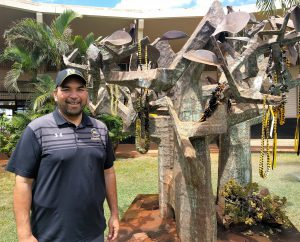 Pilialoha with a sculpture by artist Satoru Abe on the school's campus. Seniors are asked to leave a lei when they graduate as a way of saying thank you.