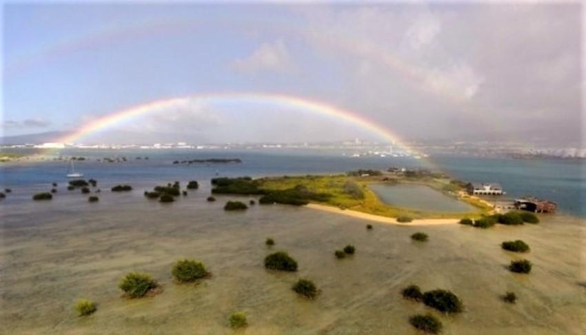 Mokauea island and fishpond and rainbow