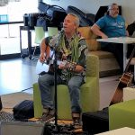 photo of Bobby Moderow Jr. playing guitar
