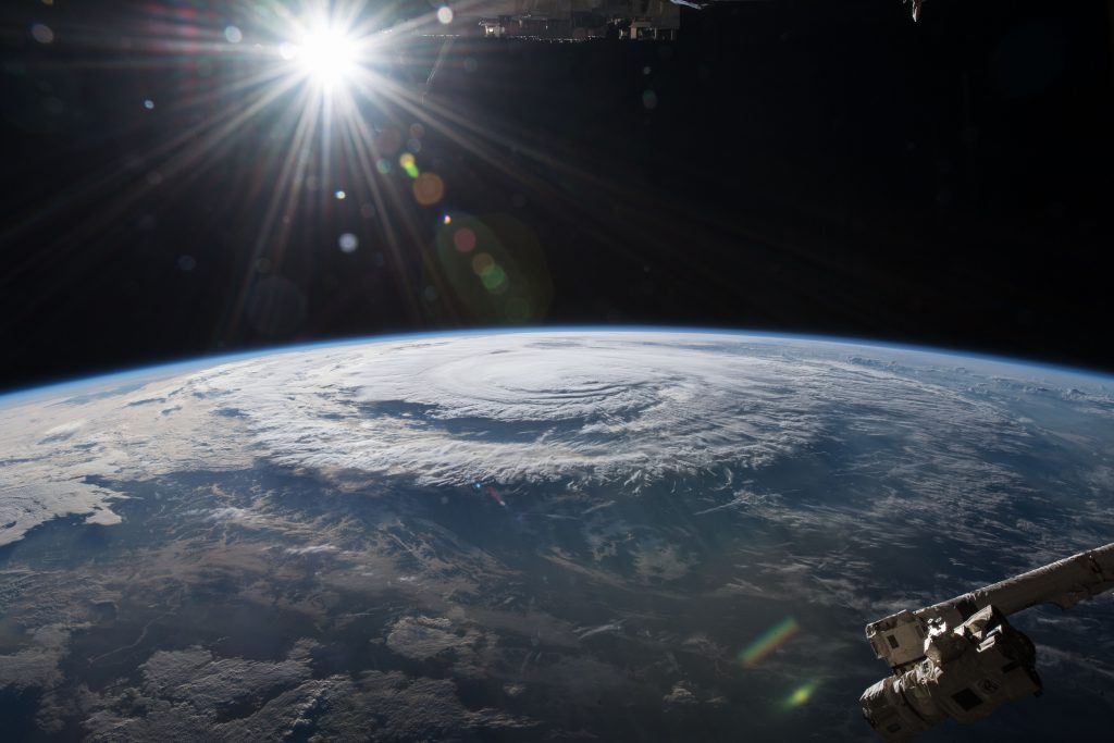 Photo of Hurricane Florence shot from space with sun shinning in distance