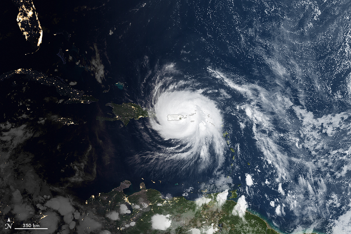 Satellite photo of Hurricane Maria with outline of Puerto Rico below