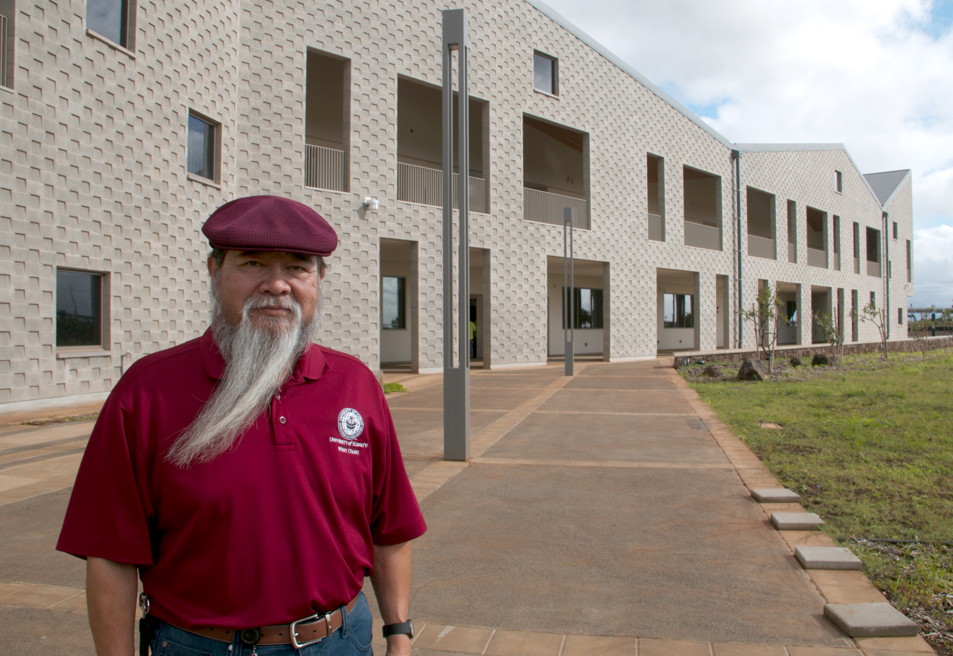 Photo of Dr. Ricardo Custodio standing in front of the new building