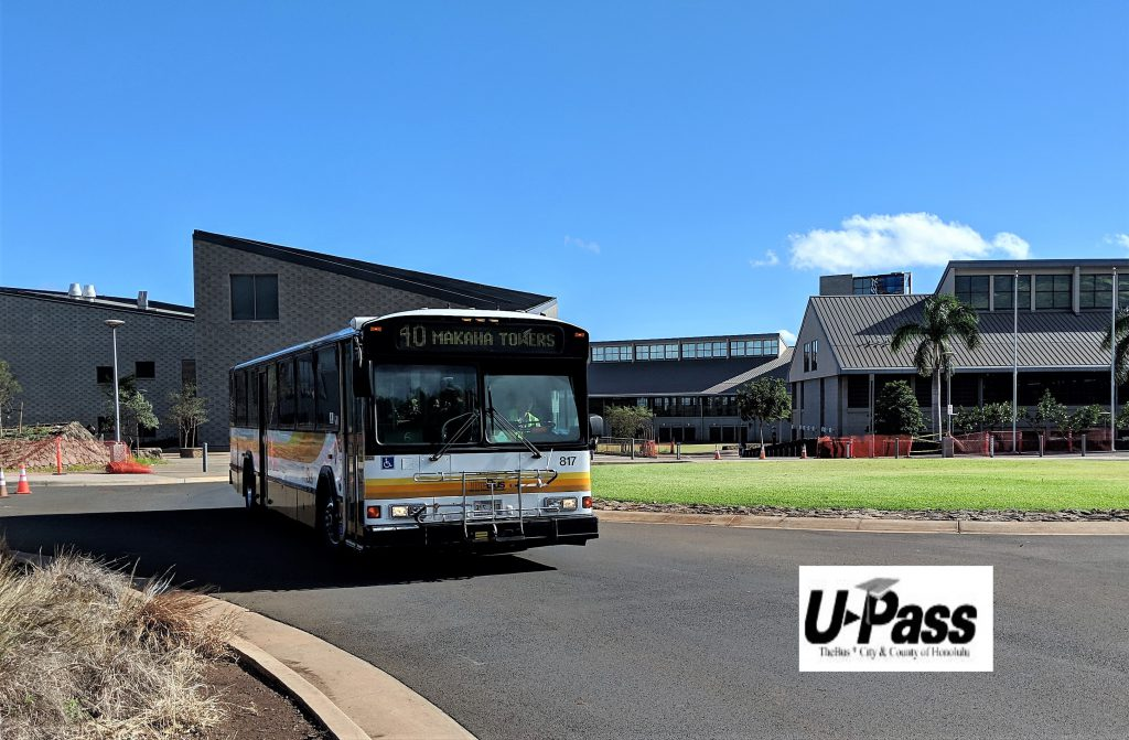 Photo of bus in traffic circle fronting the campus with words U-Pass