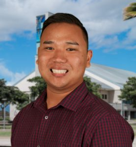 Photo of David Dinh in front of a green screen photo of UH West Oahu library tower