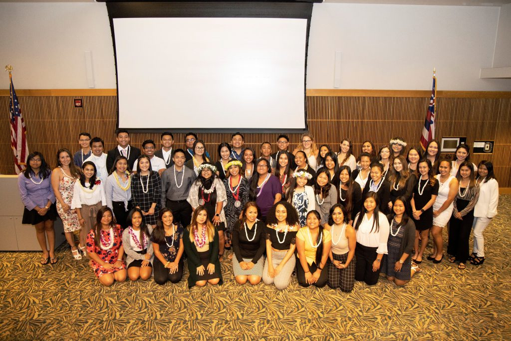Photo of more than 55 students who are standing and kneeling at the NSLS induction ceremony. The group shot was taken in the Campus Center Multi-Purpose room.