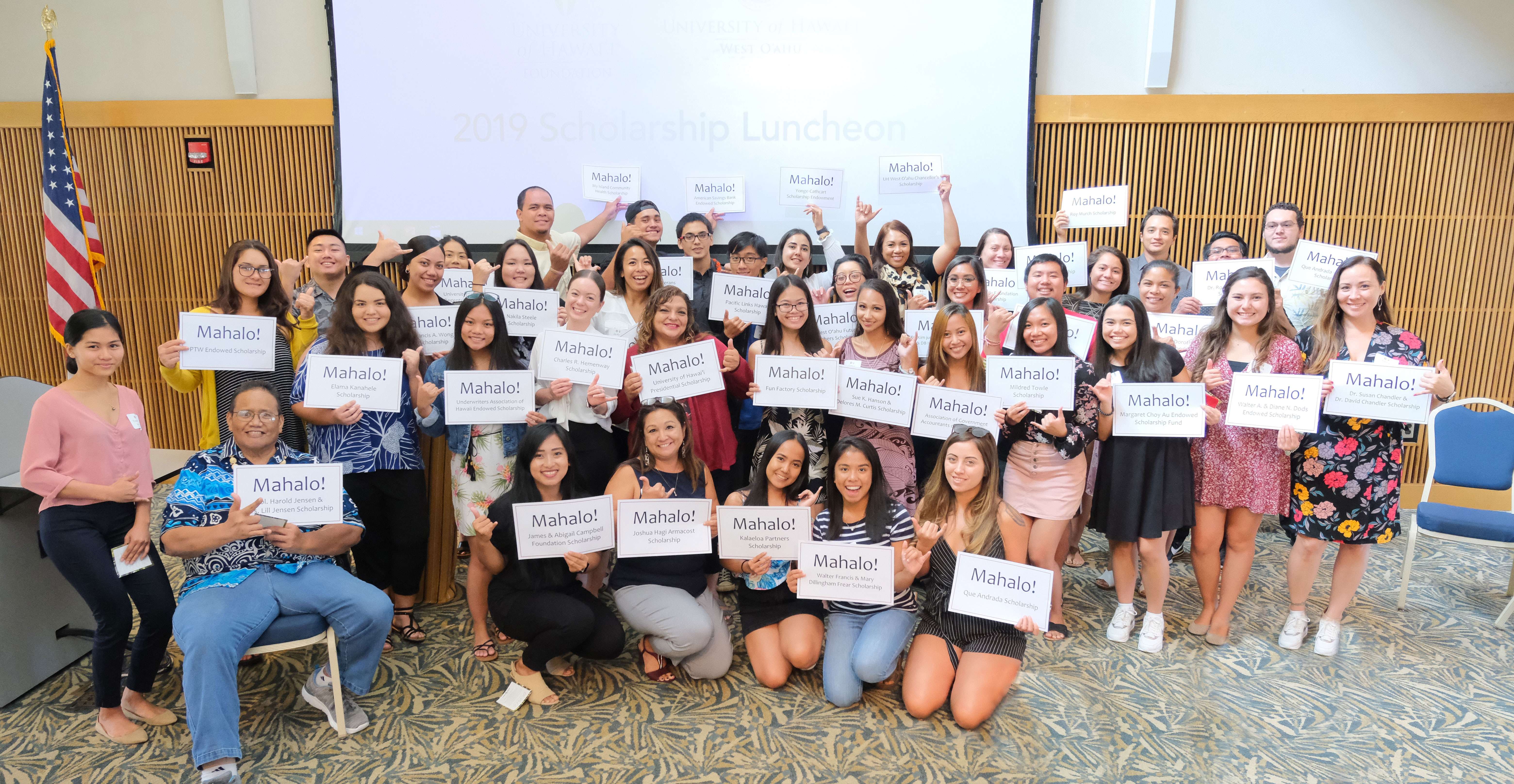 "Group of UH West Oahu students holding up ""Mahalo"" signs to thank donors."