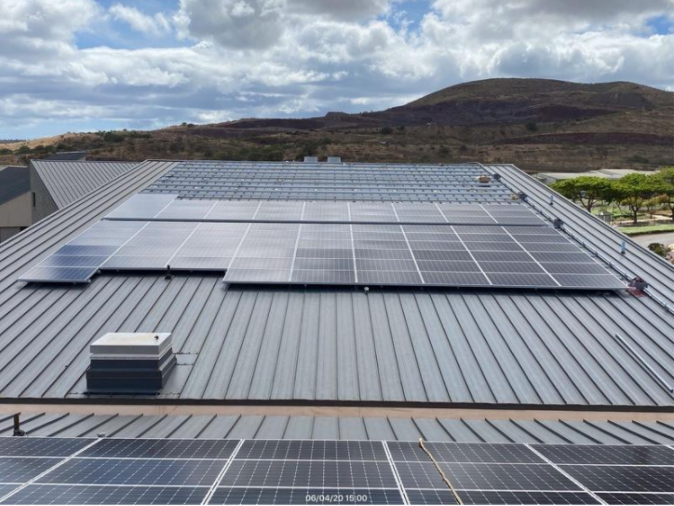 New photovoltaic panels installed on the roof of UH West Oʻahu's Administration and Health Science Building.