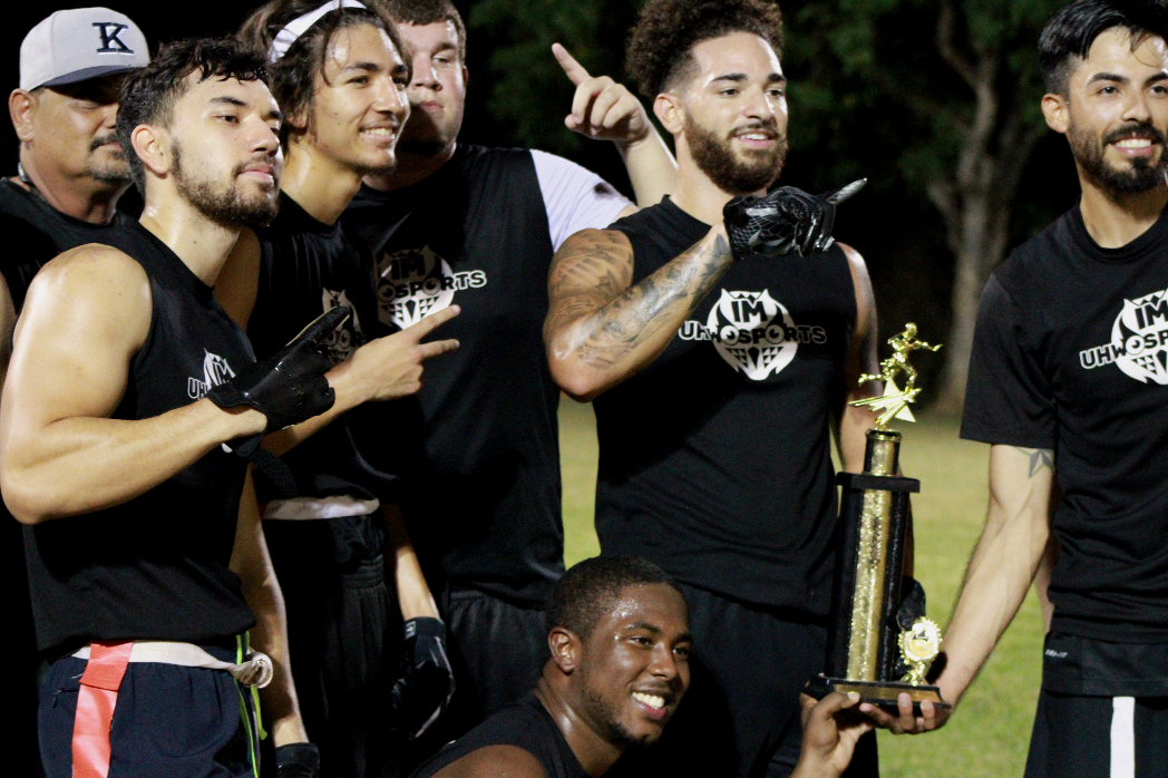 Football players pose for a group photo after winning league championship