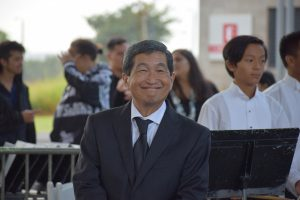Michael Nakasone smiles for a photo at the Fall 2018 Commencement Ceremony.