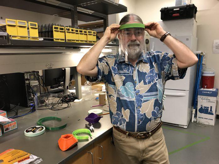 Dr. Richard Jones wearing a face shield.