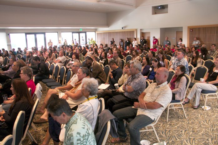 An audience of UH West Oʻahu faculty and staff listen to a presentation.