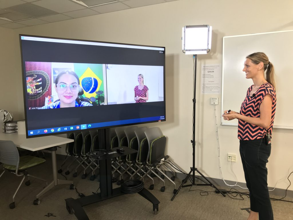 Assistant Professor in Accounting Katie Landgraf talks to one of her students, Julie Treece, via Zoom.