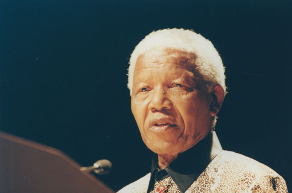 A picture of Nelson Mandela speaking into a microphone