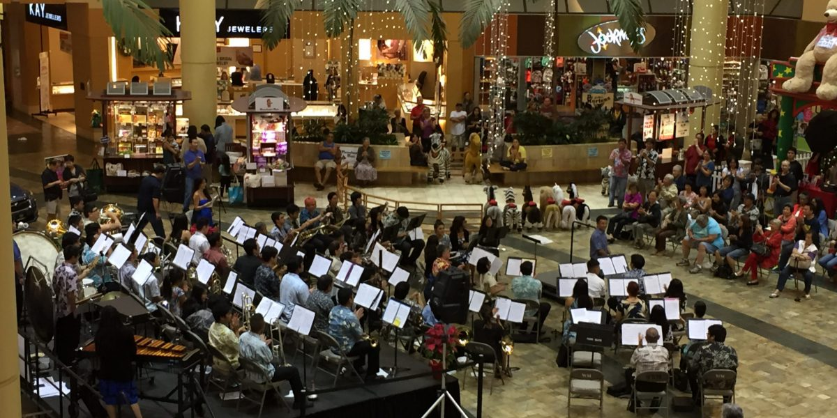 University Band performs a community concert at Windward Mall, co-directed by Chadwick Kamei and Michael Nakasone.