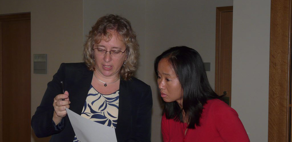 Two people looking at a piece of paper document