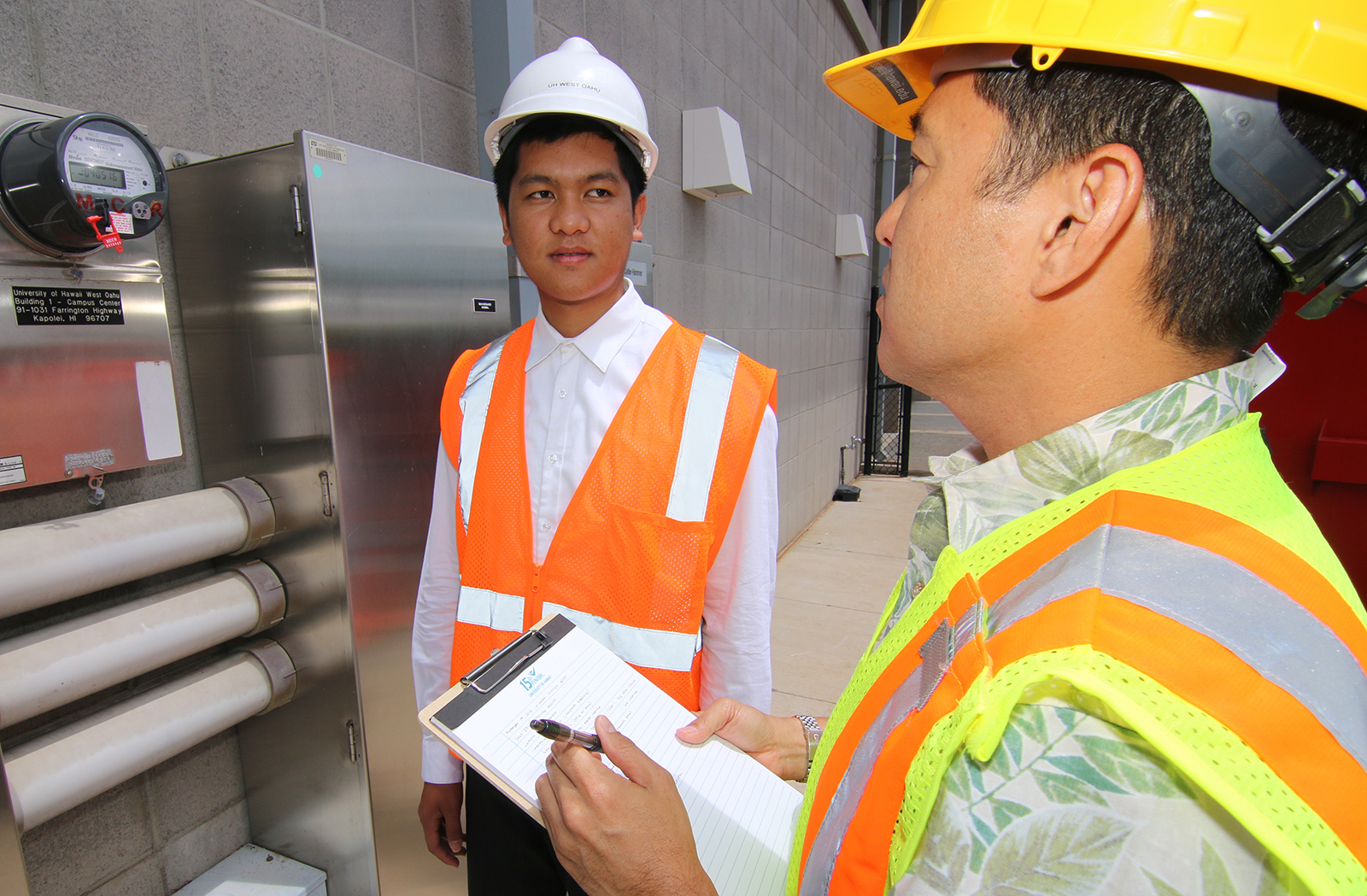 Facilities Management student getting instruction from a supervisor.