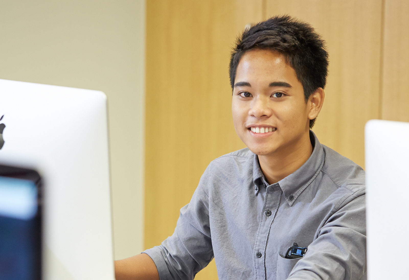 Student sitting in front of a desktop computer.