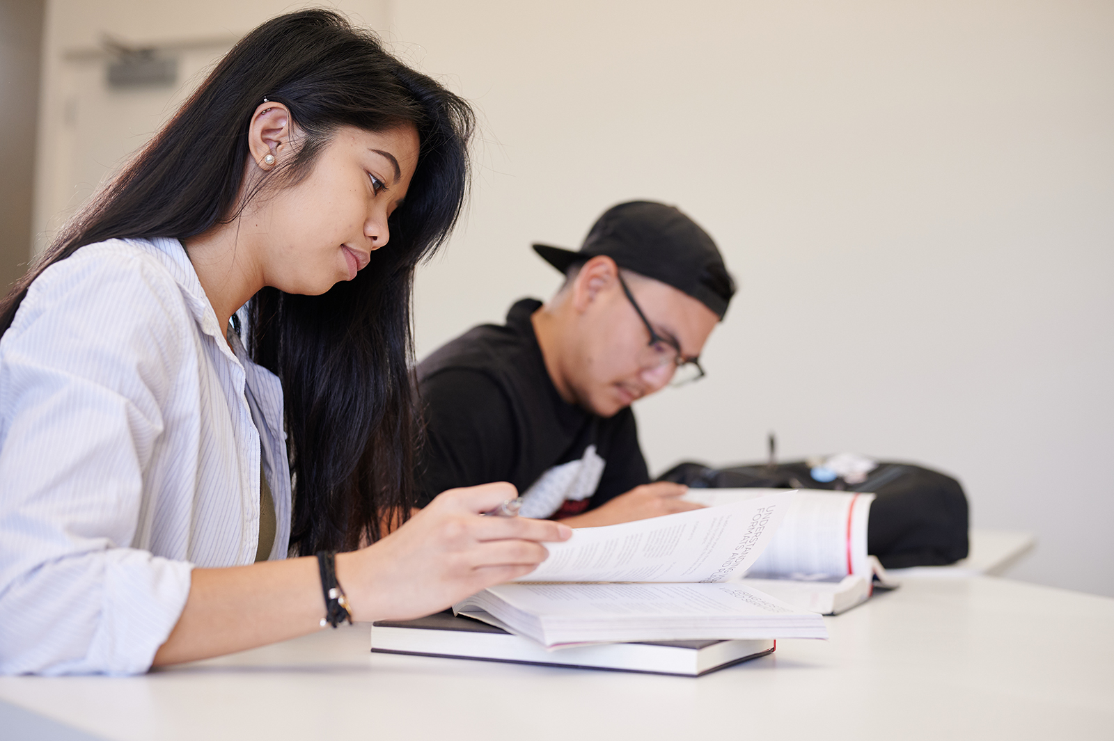 Two students studying in class.