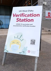 Verification Station signage in front of the Administration building.